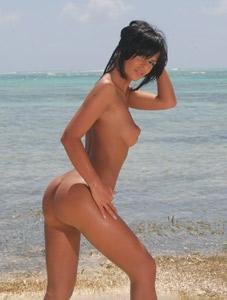 Black Angelika nude on the beach