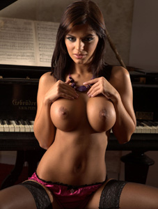Hot Black Angelika shows her big round tits